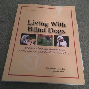 A book that says living with blind dogs.